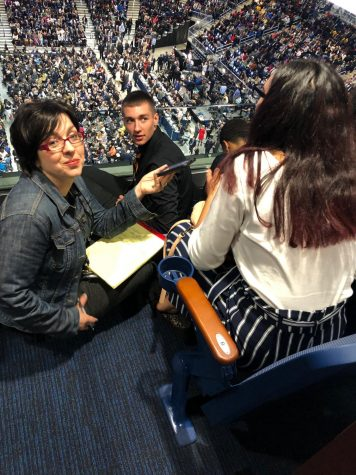Lauren Turner and members of the Tiger Eye News staff are interviewed at Wintrust Arena by Chicago Sun-Times reporter Lauren FitzPatrick. Read more below.