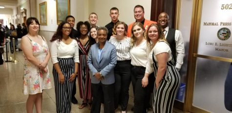 TEN Staff poses with Mayor Lori Lightfoot.