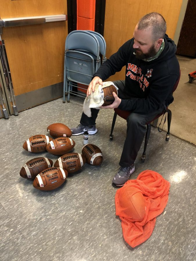 There is an art to getting footballs ready for a game. Coach Jarret Troxler explains.
